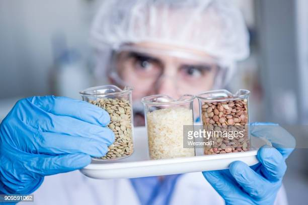 Scientist in lab examining food samples