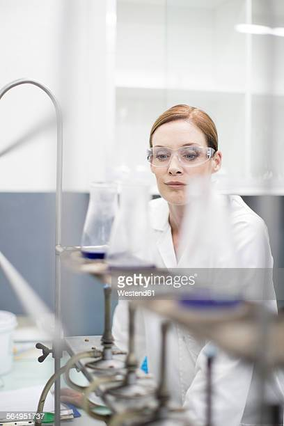 Scientist in lab working with liquids