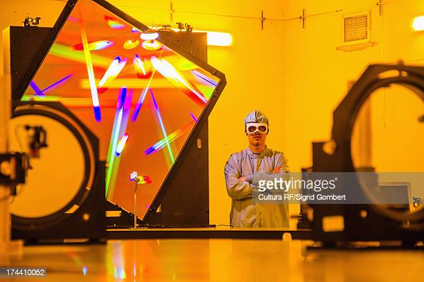 scientist in optical research lab - sigrid gombert stock pictures, royalty-free photos & images