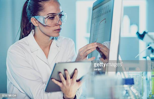 Scientist Interacting With the Computer and Digital Tablet