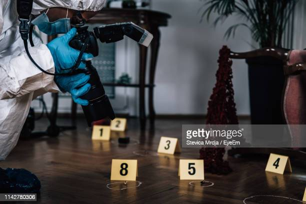 scientist investigating at crime scene - 殺人 ストックフォトと画像