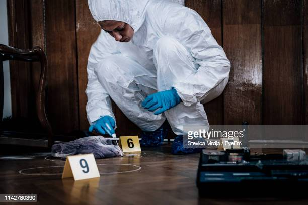 scientist investigating at crime scene - crime scene stock pictures, royalty-free photos & images