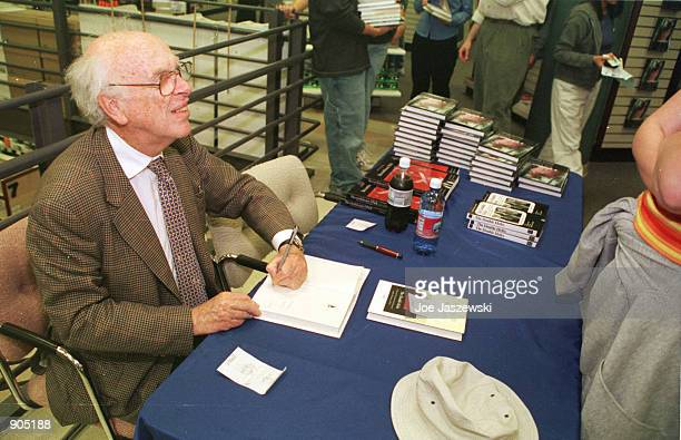 Scientist James Watson codiscoverer of the structure of DNA signs copies of his book May 8 2000 at the University of California bookstore in Davis...