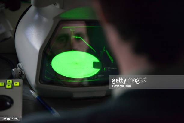 scientist looking at field emission electron microscope - scanning electron microscope stock pictures, royalty-free photos & images