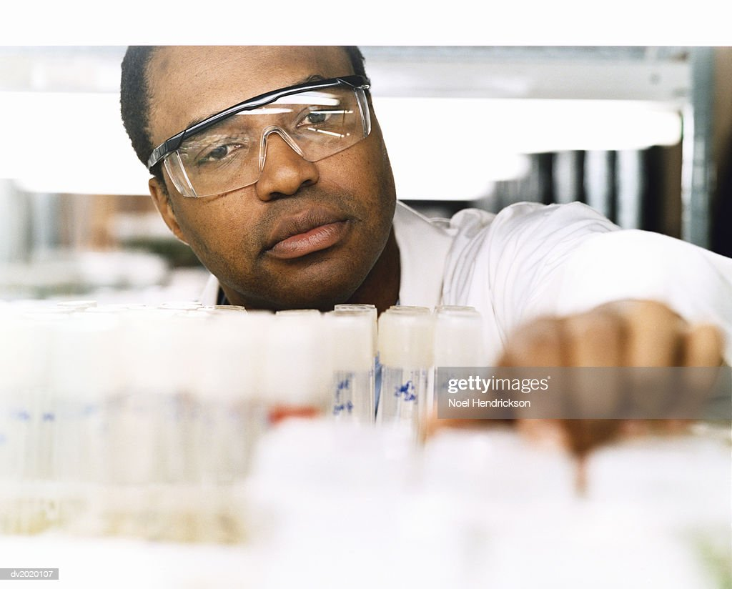 Scientist Looking at Test Tubes : Stock Photo