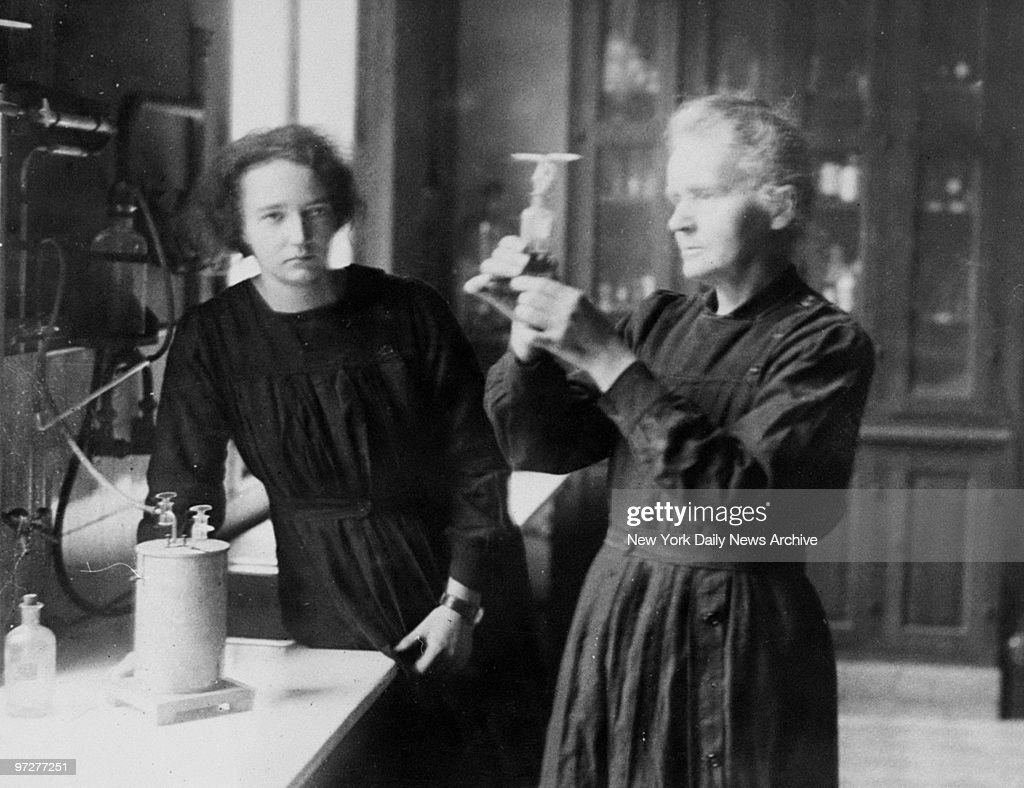 Scientist Marie Curie and daughter, Irene, working in the radium laboratory in Paris.