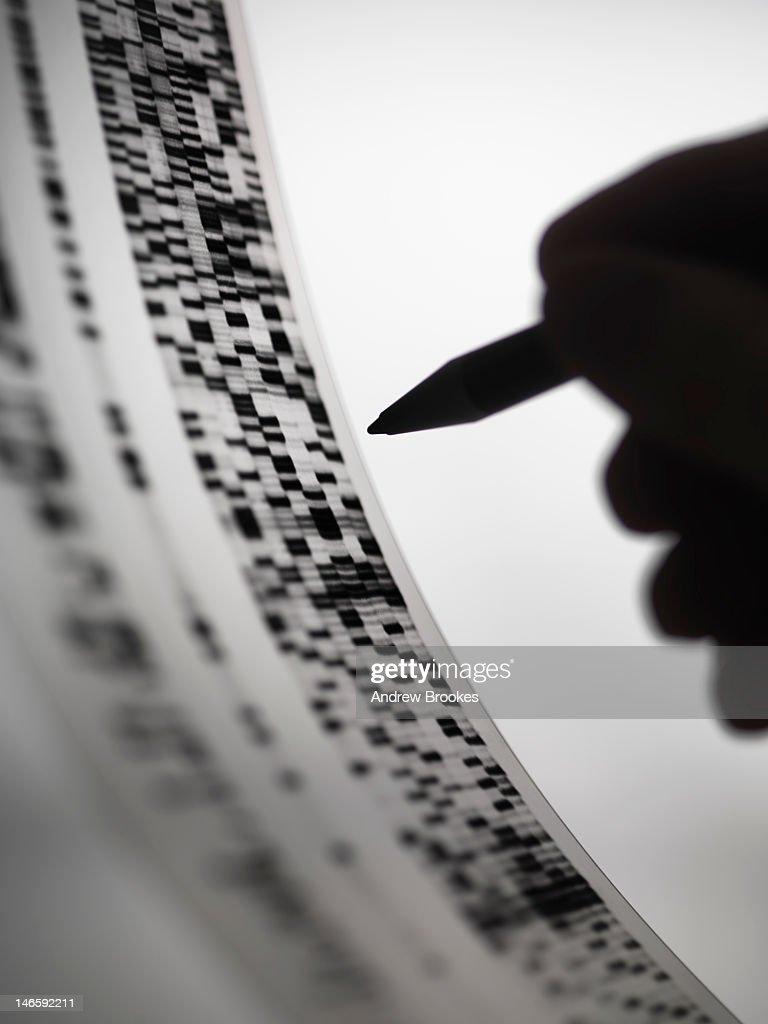 Scientist marking up DNA autoradiogram : Stock Photo