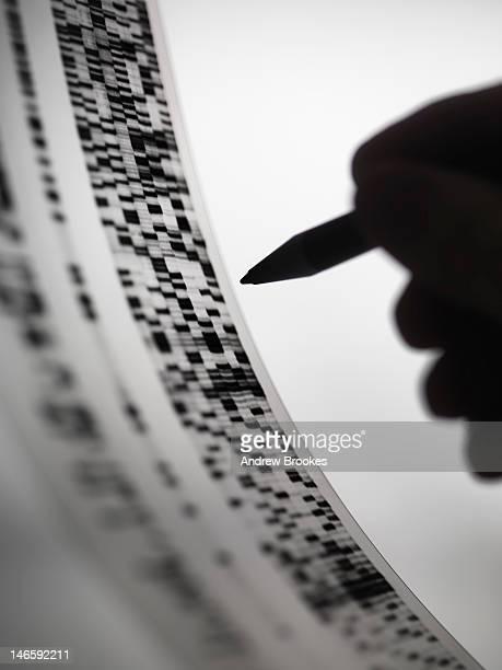 Scientist marking up DNA autoradiogram