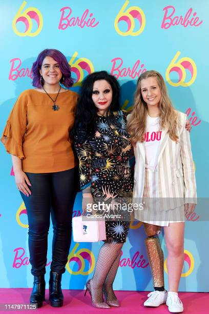 Scientist Nerea Luis singer Alaska and paralimpic athlete Desiree Vila attend a photocall to celebrate the 60th anniversary of Barbie at Allard Club...