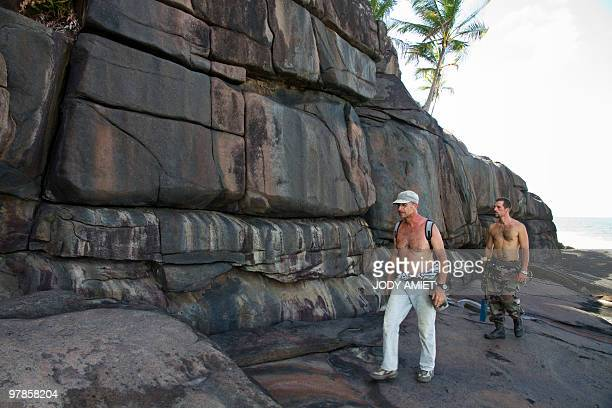 Scientist of the TerreOcean mission French geologist Eric Gilli walks on February 13 on the Devil's Island in the Caribbean Sea off French Guiana...