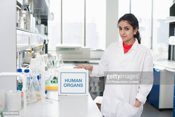 Scientist opening box of human organs in lab