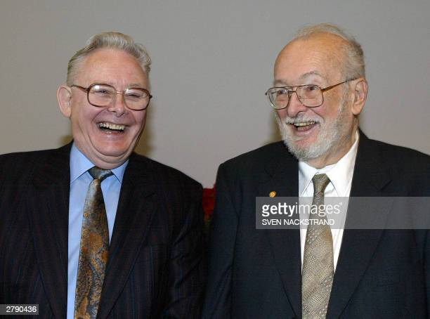 US scientist Paul C Lauterbur and Briton Peter Mansfield who jointly won the Nobel Prize for Medicine for their work on MRI share a laugh during...