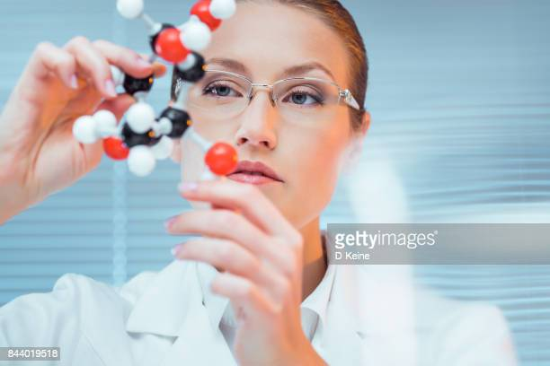 scientist - molecules stock photos and pictures