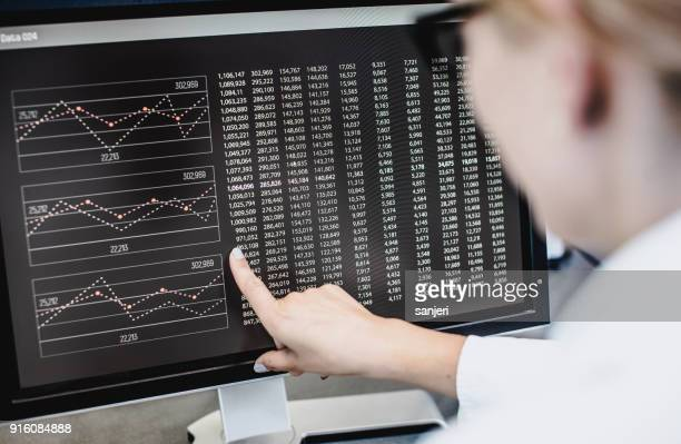 scientist pointing at computer screen - data stock pictures, royalty-free photos & images