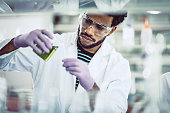 Scientist Pouring Reagent into Test tube