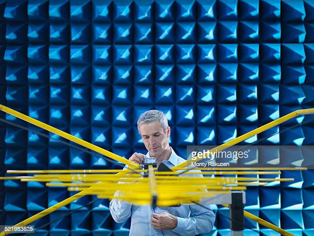 scientist preparing to measure electromagnetic waves in anechoic chamber - instrument of measurement stock pictures, royalty-free photos & images
