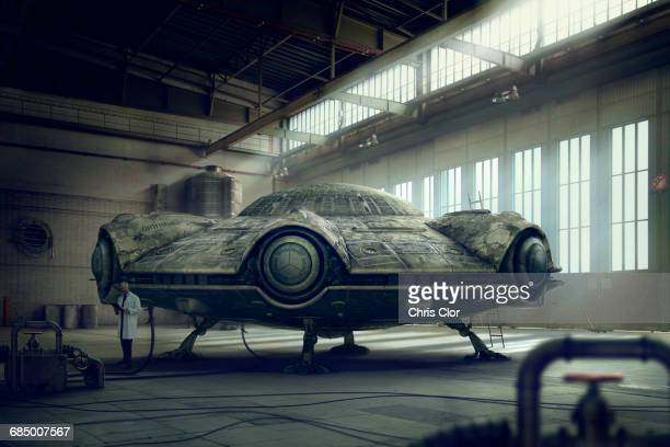 Scientist researching spaceship in hangar