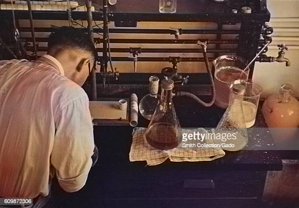 Scientist running experiments with flasks in a potato laboratory at the USDA, Beltsville, Maryland, 1935. From the New York Public Library. Note:...