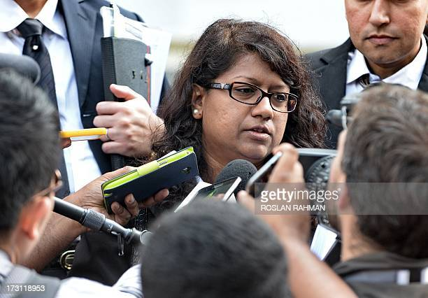 US scientist Shane Todd's family lawyer Gloria James speaks to reporters outside the Subordinate courts in Singapore on July 8 2013 A Singapore state...