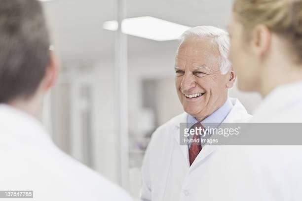 Scientist smiling in pathology lab