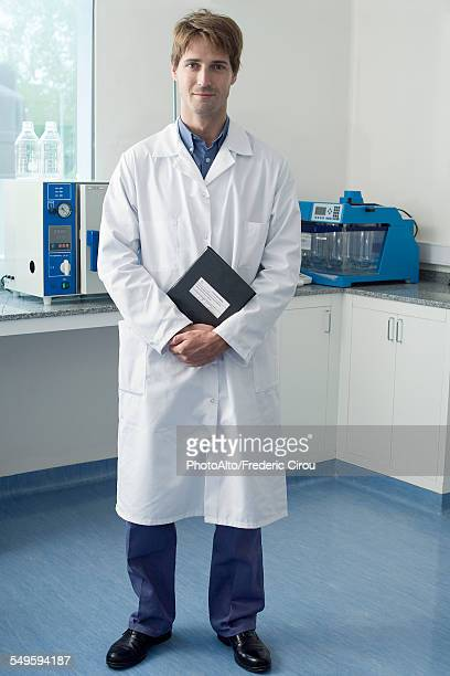 Scientist standing in laboratory, portrait