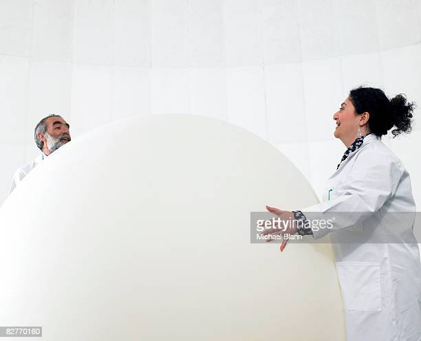 Scientist standing with weather balloon