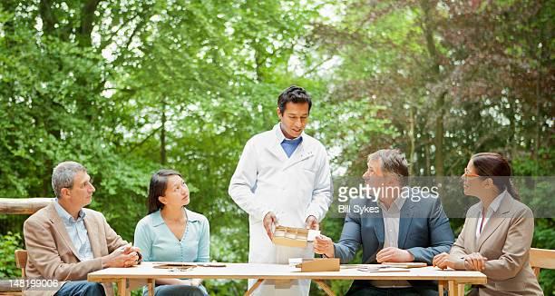 Scientist talking in meeting
