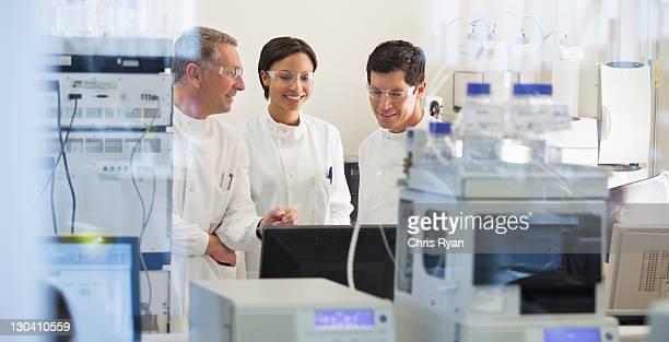 Scientist using equipment in lab