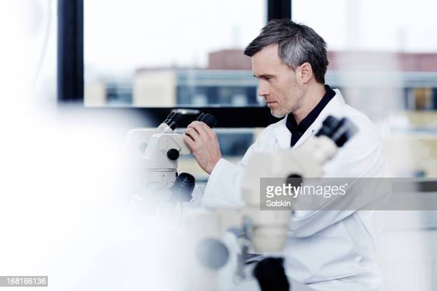 Scientist using equipment in laboratory