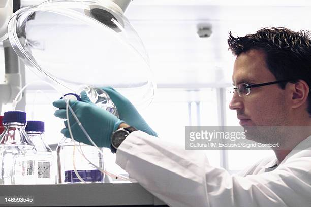 Scientist using machinery in lab