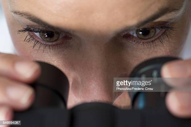 Scientist using microscope, close-up