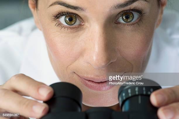 Scientist using microscope, portrait
