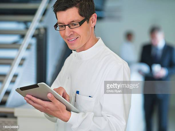 Scientist using tablet computer in office