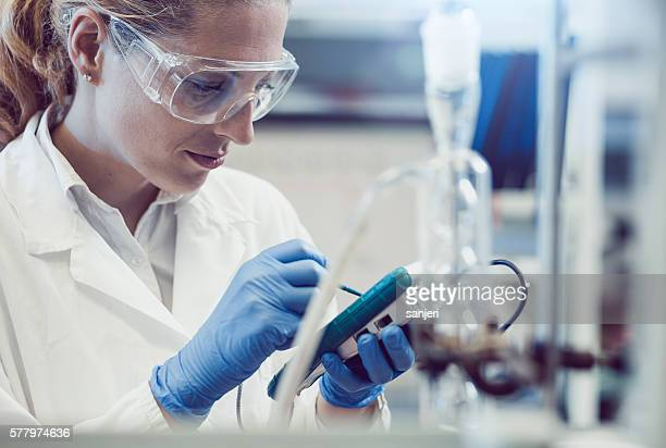 Scientist Using the Ph Meter