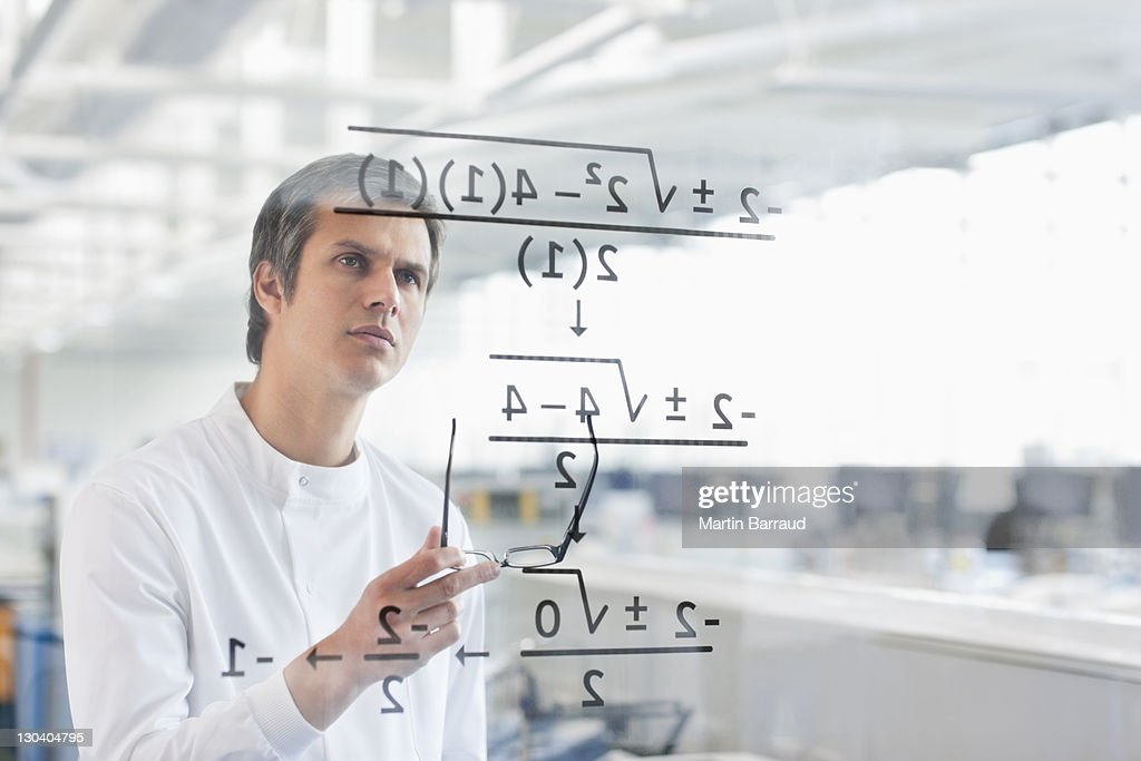 Scientist using touch screen in lab : Stock Photo