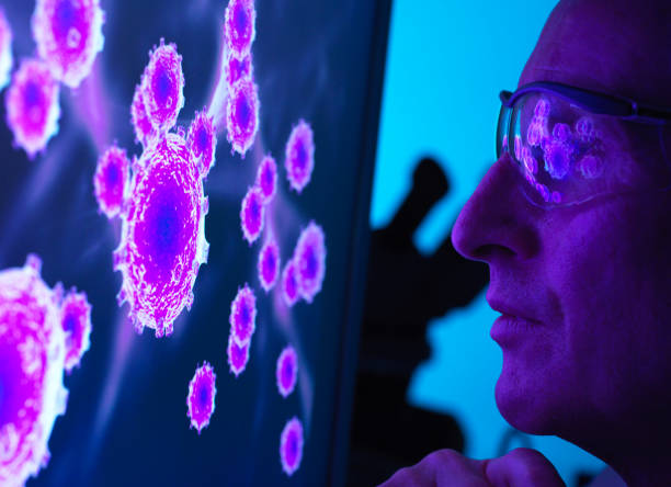 Scientist viewing a image of virus using a electron microscope in the laboratory.