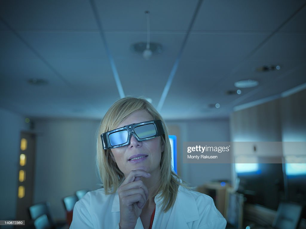Scientist wearing 3D glasses in lab : Stock Photo