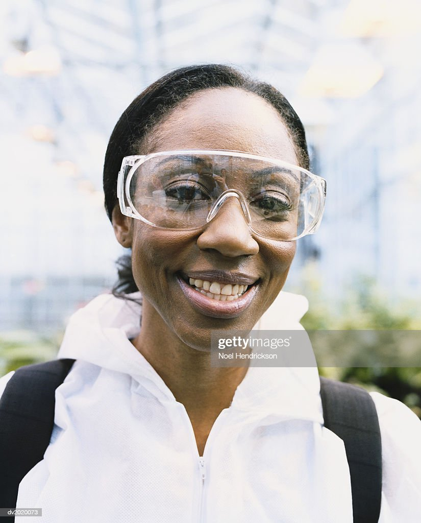 Scientist Wearing Protective Goggles in a Greenhouse : Stock Photo