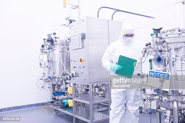 scientist with bioreactor