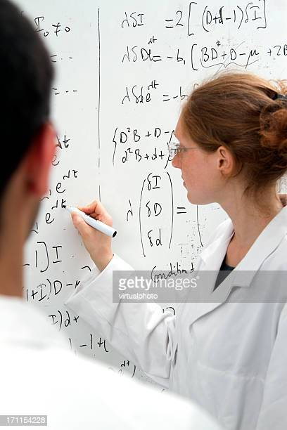 scientist woman  writing equations