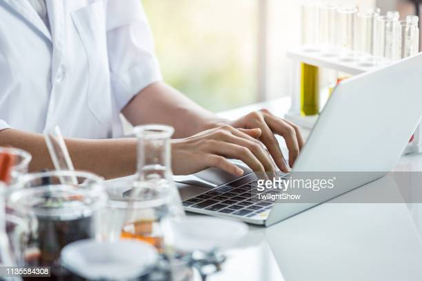 scientist women research laboratory in lab with laptop - biology stock pictures, royalty-free photos & images