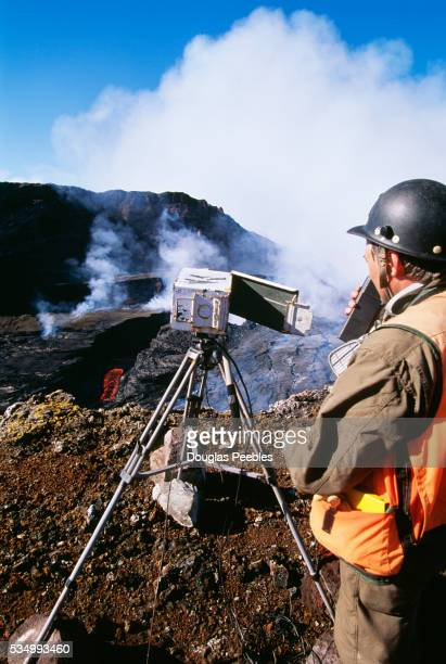 scientist working at pu'u o'o vent on kilauea volcano - pu'u o'o vent stock pictures, royalty-free photos & images