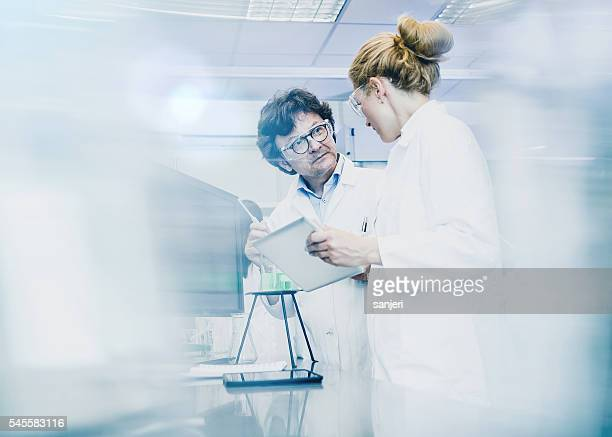 scientist working at the laboratory - soft focus stock pictures, royalty-free photos & images