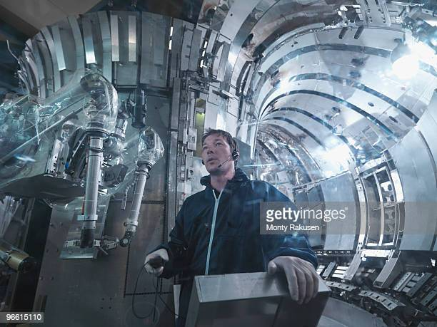 scientist working in a fusion reactor - monty rakusen stock pictures, royalty-free photos & images