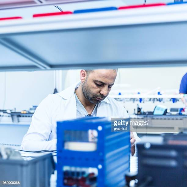 scientist working in laboratory - graphixel stock pictures, royalty-free photos & images