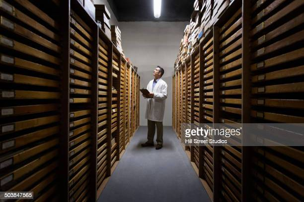 Scientist working in museum archive