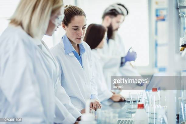 scientist working in the laboratory - place of research stock pictures, royalty-free photos & images