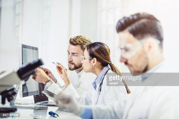 scientist working in the laboratory - hematology stock photos and pictures