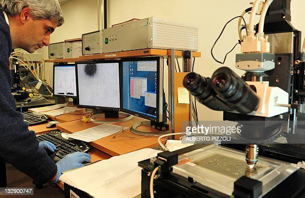 Scientist works at the scanning laboratory of the Oscillation Project with Emulsion-Racking Apparatus detector at the Gran Sasso National Laboratory...