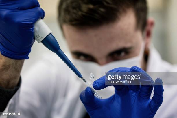 Scientist works on Covid-19 samples to find variations of the virus, at the Croix-Rousse hospital laboratory in Lyon, central eastern France, on...